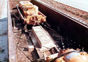 A Vulcan 030 secured for rail shipment. Rail shipment was common in the 1960's and 1970's, but the railroads' concentration towards containerised and bulk freight from the 1980's onward made the shipment of hammers impractical. The hammer had to be well secured to the car; rail car handling can be rough.