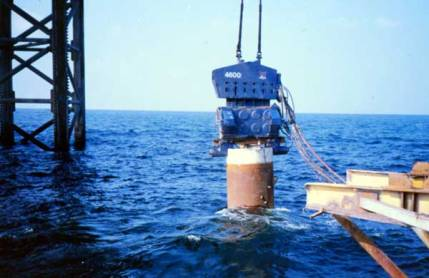 Steam hammers weren't the only type of pile driving equiment Vulcan sent offshore; this Vulcan 4600 vibratory hammer is shown driving piles into the Gulf in the early 1990's. Vibratory hammers were an excellent choice in certain applications, and they were naturally adept at underwater driving.