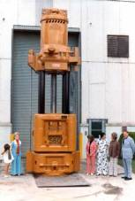 The first Vulcan 560 hammer, at the Chattanooga facility in 1973, with some of the employees. The 560 was Vulcan's first 5' stroke hammer; it was immensely successful and become the most important hammer in the Vulcan offshore line, and its introduction was a major step upward for Vulcan.