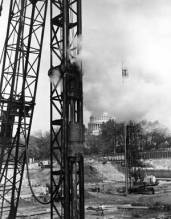 """At the seat of power: a Vulcan #0 driving 12"""" pipe piles for an addition to the House of Representatives in Washington, DC. The Capitol dome itself can be seen in the background. The contractor was McCloskey Enterprises of Philadelphia. (Photo by Adams Studio, Washington)"""