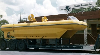 """Vulcan: The Offshore Experience Without a doubt the most intriguing """"special product"""" Vulcan's West Palm Beach facility produced was the Construction Assistance Vehicle (CAV). The purpose of this was to provide an underwater craft to transport personnel and materiel during underwater construction. The CAV was capable of transporting one U.S. Ton (2000 lbs.) at a speed of 2 knots. It was intended to be manufactured using ordinary materials and fabrication techniques. Vulcan fabricated the hull for the U.S. Navy and loaded it out for shipment 29 November 1969. Below: on the trailer, ready for transport to California. An aft view of the CAV. A better view of the deck. Once in California, it was fitted out with its propulsion system and prepared for testing. Below, as completed and ready."""