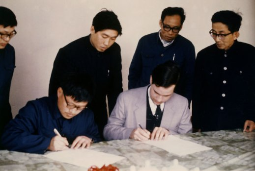 Signing the contract. For the Chinese, Dong Xinli, and myself for Vulcan. Overseeing the ceremony (between us) is Yang Zhanwen from the Bank of China.