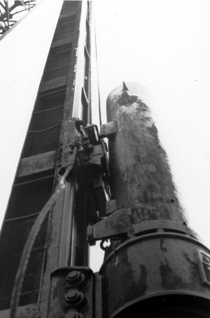 A Delmag diesel hammer using a European spud-type leader. Although not a Vulcan hammer, this photo was taken in the process of preparing a bid for Vulcan to design and fabricate the leaders for this hammer. Photo taken near West Palm Beach, FL.