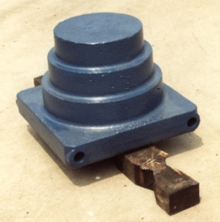 "The one successful ""spin-off"" from the diesel program: the universal adapter base and filler (above, in this case a pipe cap) developed for the diesel hammers. They also proved to fit other diesel hammers and were in the company's product line until it was merged in 1996."