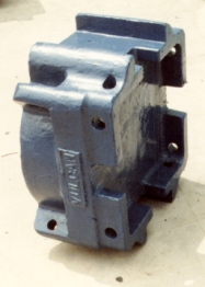 "The one successful ""spin-off"" from the diesel program: the universal adapter base (above) and filler system developed for the diesel hammers. They also proved to fit other diesel hammers and were in the company's product line until it was merged in 1996."