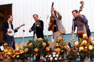 The Dismembered Tennesseans, a local bluegrass band, performs for the dedication. At the right on the bass is Ansley Moses. In his regular work as an officer of the American National Bank, he helped facilitate the Industrial Revenue Bonds that made the plant expansion possible.