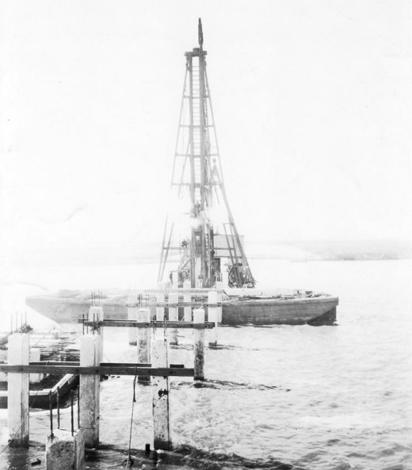 Another one of Col. Doullut's enterprises at work, in this case Doullut and Ewin driving piles for a bridge across the Blakley River at Mobile Bay on 3 November 1926. Although many of the contractors depicted in the early photographs have come and gone, this one is an interesting exception: J.P. Ewin moved the firm to Mobile in 1946, and today it is the well known engineering firm of Volkert, Inc.