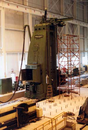 Inside the plant expansion during the latter phases of construction, July 1980. Shown is the Innocenti horizontal boring mill. Boring mill capacity was the lifeblood of hammer production, especially with the long cylinder bores. Floor plates and a rotary table are to be installed in front of the machine.