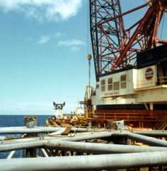 A Vulcan 040 hammer, about to be picked off of the deck of Ingram Contractors, Inc. Derrick Barge 3 during a platform installation in 1966. Ingram is a well known name in both the marine and the book distribution business, but Ingram sold the marine construction operation to McDermott.