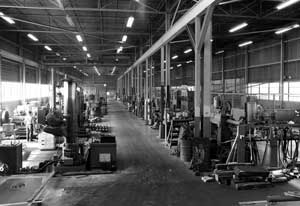 A view down the main aisle of the Chattanooga facility in 1968. The boring mills and larger lathes were to the left of the aisle; the smaller machines and the stockroom were on the right. The photo is taken from the assembly area; the shipping area is at the far end.