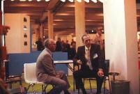 "Vulcan's Chairman of the Board and President Henry Warrington (right) making a point with R.G. ""Dick"" Castle, who represented Vulcan's product in California, at the 1974 OTC. Vulcan booths were designed primarily to allow extended meetings with Vulcan's distributors and customers."