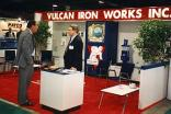 "The appointment of Dave Horsman as President of Vulcan in 1991 marked the return of Vulcan to OTC on a regular basis. Here he's shown (on the right) ""manning the booth"" at the 1994 OTC. The photo also shows the last booth Vulcan built for OTC. Vulcan continued to exhibit at OTC after Cari Capital acquired the business in 1996, using the same booth shown. Vulcan Iron Works' last OTC was 1999; by then the financial woes of the company made further participation impossible."