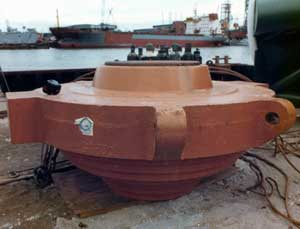 """Classic Vulcan offshore pipe cap; this photo is from 1978. Vulcan preferred a """"beehive"""" or """"female"""" cap. The advantage was the more direct transfer of force; the disadvantage is that the steps had to be custom machined (or shimmed) to the pipe inside diameter. Peeking out above the cone is the top plate; the welding bottles are actually behind the cap. Below the top plate the cushion material was placed."""