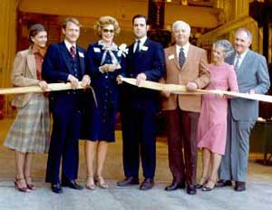 The following year, on 11 October 1980, the plant was dedicated; here is the ribbon cutting. From left to right: Sharon Warrington; her husband Pem Warrington (1953-1995), Executive Vice President; Mrs. Warrington; Don Warrington, President; Louis M. Venture, member of the Board of Directors; Fayrene Bridges; her husband W. Calvin Bridges, Executive Vice President and Treasurer.