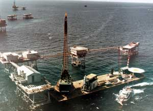 When we think of a platform, we usually think of a single structure, but many platforms were in reality complexes of structures joined together into small offshore cities. The 1968 photo below shows the last module for such a structure about to be placed on the deck of the platform. Such complexes were not unique to the Gulf of Mexico; they also appeared in the North Sea and other places around the world.