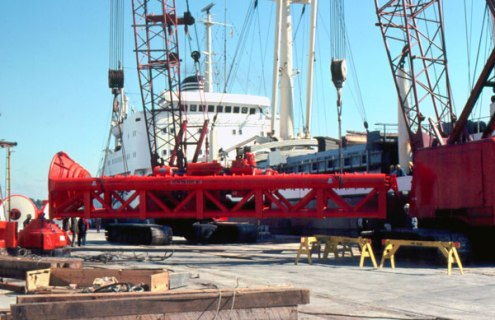 Another view of loading out a hammer package, this time being lifted off of the quay to be set on the deck of the ship.