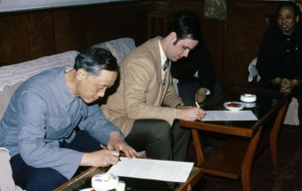 The webmaster (signing, on the right, He Ping for the Chinese on the left) the contract to sell a Vulcan 560 package with spare parts, steam hose and a Johnston marine fire tube boiler to the Petroleum Corporation of the People's Republic of China.