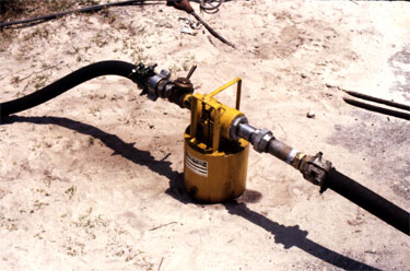 The Vulcan Sight Feed Line Oiler, which uses an injection similar to a carburettor. This is similar in concept to the McCall Lubricator featured on many Raymond rigs. The lubricant tank is integral to the unit, below the air/steam inlet/outlet. Simple in concept and operation, it made it easy to keep the cylinder lubricated. This oiler is lubricating Vulcan's experimental Single/Compound hammer; usually the oilers were mounted on the air compressor or near the boiler in a more permanent fashion.