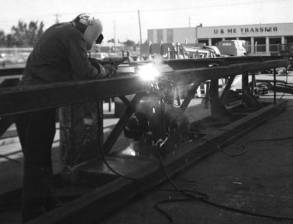 Welding onshore leaders at the Special Products Division. In the background (and across the street) is U and Me Transfer and Storage, which was very useful when things needed to be moved. Onshore leaders were one reason why the plant was built, but because of geography and other factors, the facility had a hard time being competitive with this part of the product line.