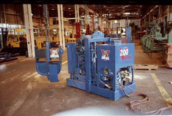 Vulcan's smallest vibratory hammer, the 200 (later 400) in the shipping department at Vulcan's Chattanooga facility, August 1987. Behind it is a good view of the original shop.