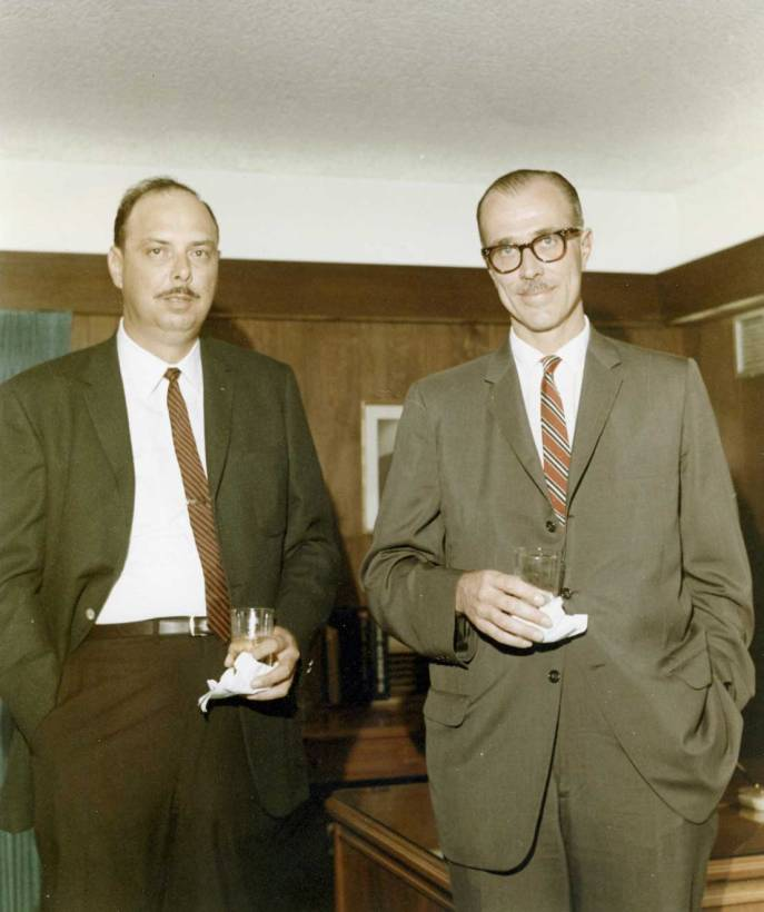 Ken Wiggs of Wiggs and Maale Construction, which built the office, is shown at left with Henry G. Warrington, Chairman of the Board and President.