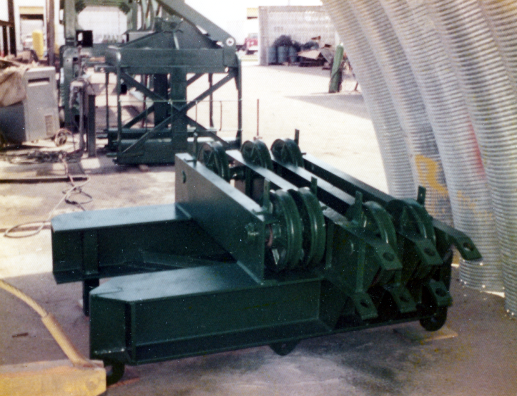 A headblock for leaders the Special Products division built for the U.S. Army. Headblocks are essential with fixed leaders as the lines which raise and lower the hammer, lines for picking up the pile, and in some cases lines for drills and other accessories are included.