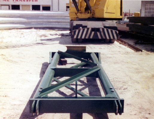 A telescoping spotter with manual adjustment for the extension and no provision for side-to-side motion for the batter. The simplest form of spotter.