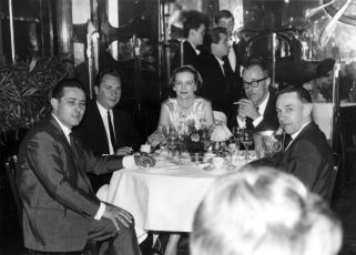European travel wasn't all machine shops, though: my mother (in the centre) and my father (to her left, your right) at Maxim's in Paris, probably 1966. Photo by Jaques Sabrou, Paris.