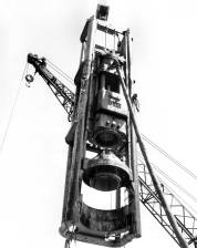 A Vulcan 020 getting ready to drive concrete cylinder piles for the Fort Randall Bridge Project, 10 October 1963. The contractor was Peter Kiewit & Sons. The stub type leaders were fabricated by Conmaco. This setup also included suspension type cables at the top of the hammer. It presaged most of Vulcan's offshore setups during the next several decades.