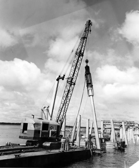 "Cleary Brothers Construction, West Palm Beach, FL, driving 20"" sq. prestressed concrete piles on a batter with a Vulcan 0R operated with an Ingersoll-Rand 600 CFM compressor and a barge mounted Lima Crane on 1220' bridge across St. Johns River between Seminole and Volusia Counties, State Road 46. Courtesy of Dixie Contractor."