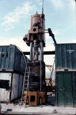 Stacking it up: an ingenious use of containers as scaffolding to finish assembling the Vulcan 5100 hammer.