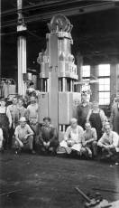 """Some of Vulcan's employees around a """"big"""" (for the time) Super-Vulcan hammer at Vulcan's 327 North Bell Avenue facility in Chicago."""