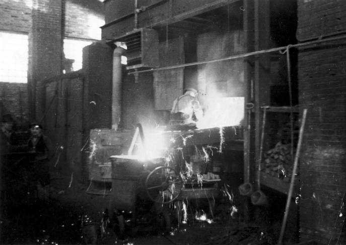Sparks fly at the Vulcan foundry. The company started out as a foundry and maintained one until after World War II at it's 327 North Bell Avenue facility in Chicago.