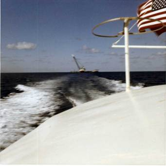Leaving the barge behind: the wake and Ingram's derrick barge in the Gulf of Mexico, August 1966. Ingram had bought the first 040 hammer Vulcan had made; it experienced growing pains, thus the trips to the barge. It was good to get the job done and go home.